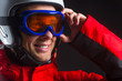 Close up of active smiling guy in ski hamlet and glass mask.
