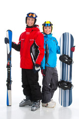 Happy smiling couple of snowboarder and ski rider