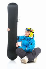 Beautiful female snowboarder sitting with snowboard in hands