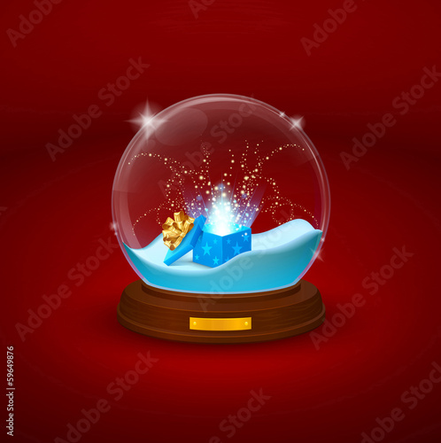 glass bowl statuette with snow and open gift inside