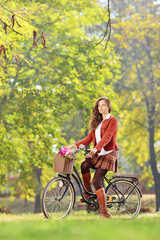 Beautiful female on a bicycle in a park