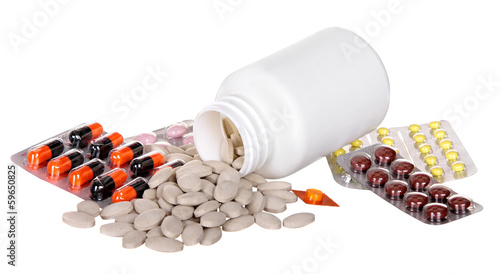 various medicines, pills and syringes on a white background with