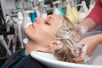 hair washing at a hairdressing salon, young caucasian girl