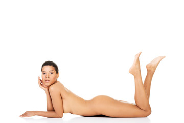 Attractive woman lying on her belly with legs up.