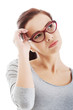 Portrait of thoughtful woman in eyeglasses.