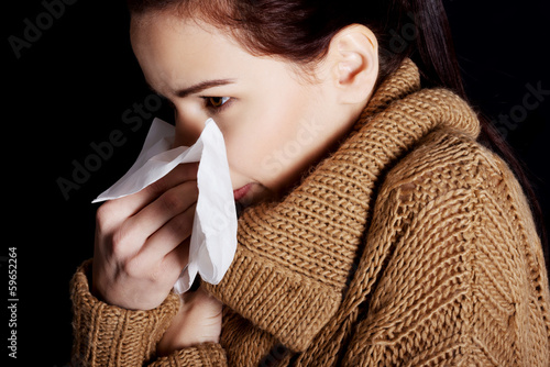 Young beautiful woman with tissue.