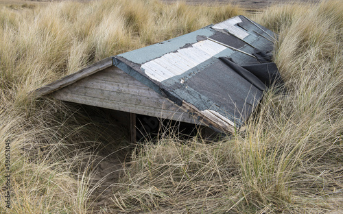Beach Hut Buried in Sand at Brancaster, Norfolk, UK