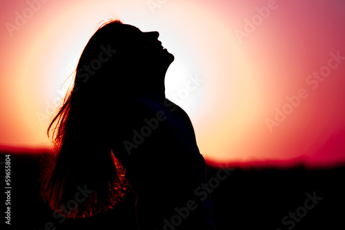 Woman relaxing at sunset