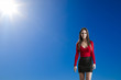Beautiful woman against a blue sky