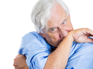 Stressed, anxious, scared old man biting his arm