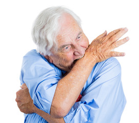Nervous, stressed old man biting his hand