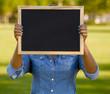 Holding a shalkboard