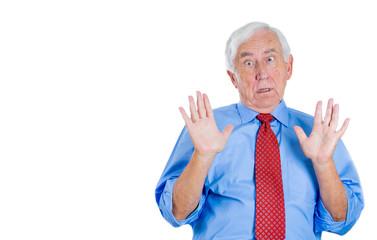 Shocked, surprised old business man in denial
