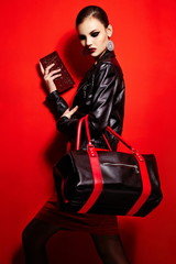 glamor stylish brunette in black jacket with bag bright makeup
