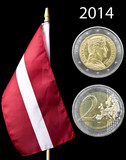 National flag and 2 euro coin of Latvia isolated on black
