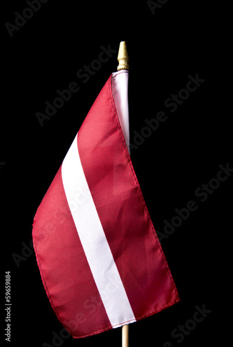 National flag of Latvia isolated on black