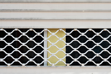 Pattern metal grille gate close-up.