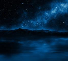 Mountain lake with stars