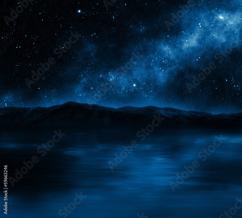 Mountain lake with stars