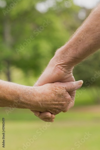E lderly couple holding hands