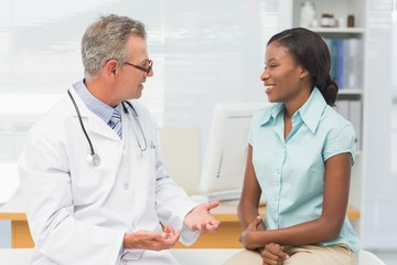 Doctor speaking with cheerful young patient