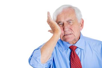Sad, unhappy old man having a tooth ache, headache
