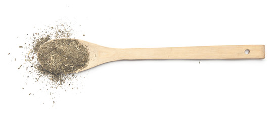 Dried estragon spice and wooden spoon