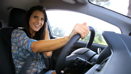 Shy woman driving car seducing