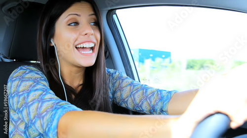 Happy woman enjoying phone call while driving car