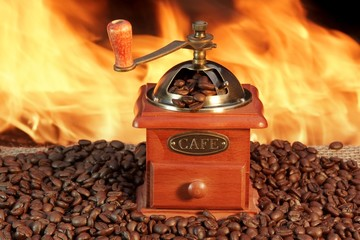 Old Coffee Grinder and Roasted Coffee Beans