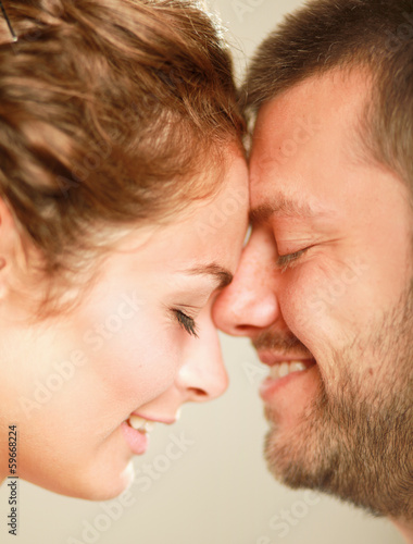 Young man and woman together over white background/