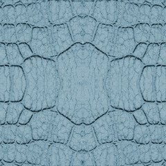 fragment of snake skin painted in blue closeup