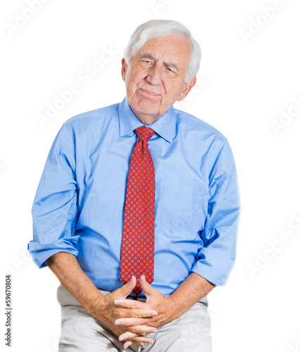 Confused elderly man, deep in thought, trying to remember