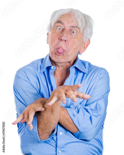 Crazy, agitated, unhinged, old  man sticking tongue out