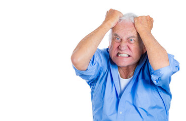 Stressed old man pulling out his hair, completely desperate