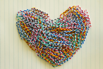 Colorful of paper clip in heart shape