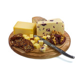 Cheese board with three cheeses and cheese knife on white backgr
