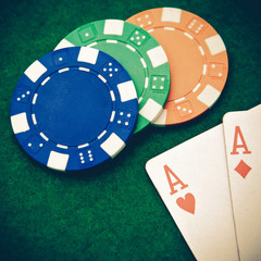 Vintage - Texas holdem pocket aces on casino table with copy spa