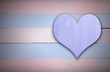 Purple heart sign on blue and pink retro wooden panel background