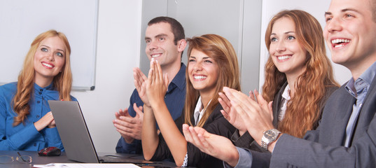 Five young business people applauding