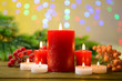 Candles and Christmas decoration on bright background