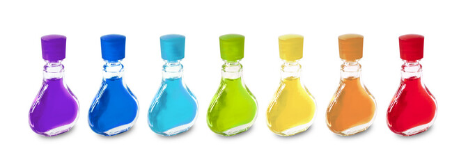 Colorful mini bottles on white background