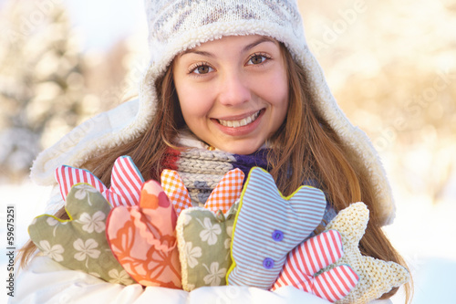 Winter. Young woman with heart shapes outdoor.