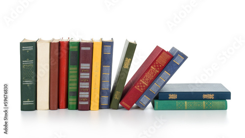 Pile of books isolated on white background.