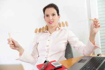 young businesswoman with neck pain uses massager