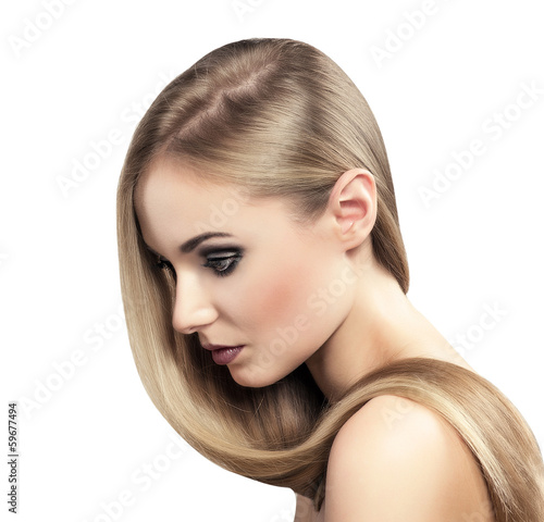 Natural straight hair model posing in studio, isolated