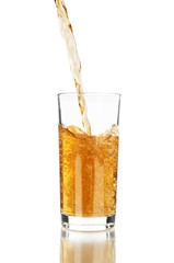 pouring fresh apple juice on a white background