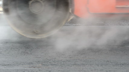 steam compactor roller at road work