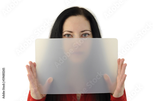 Lady holding a transparent board half hiding her face