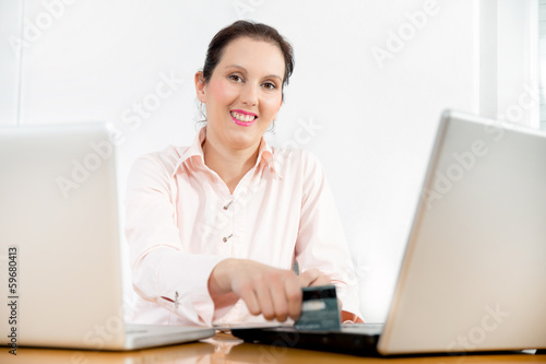 Happy Woman shopping with credit card and computer